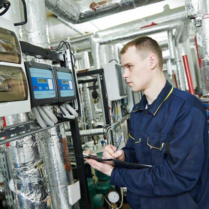 technician checking equipment   Air Compressor daily checks   Air Equipment